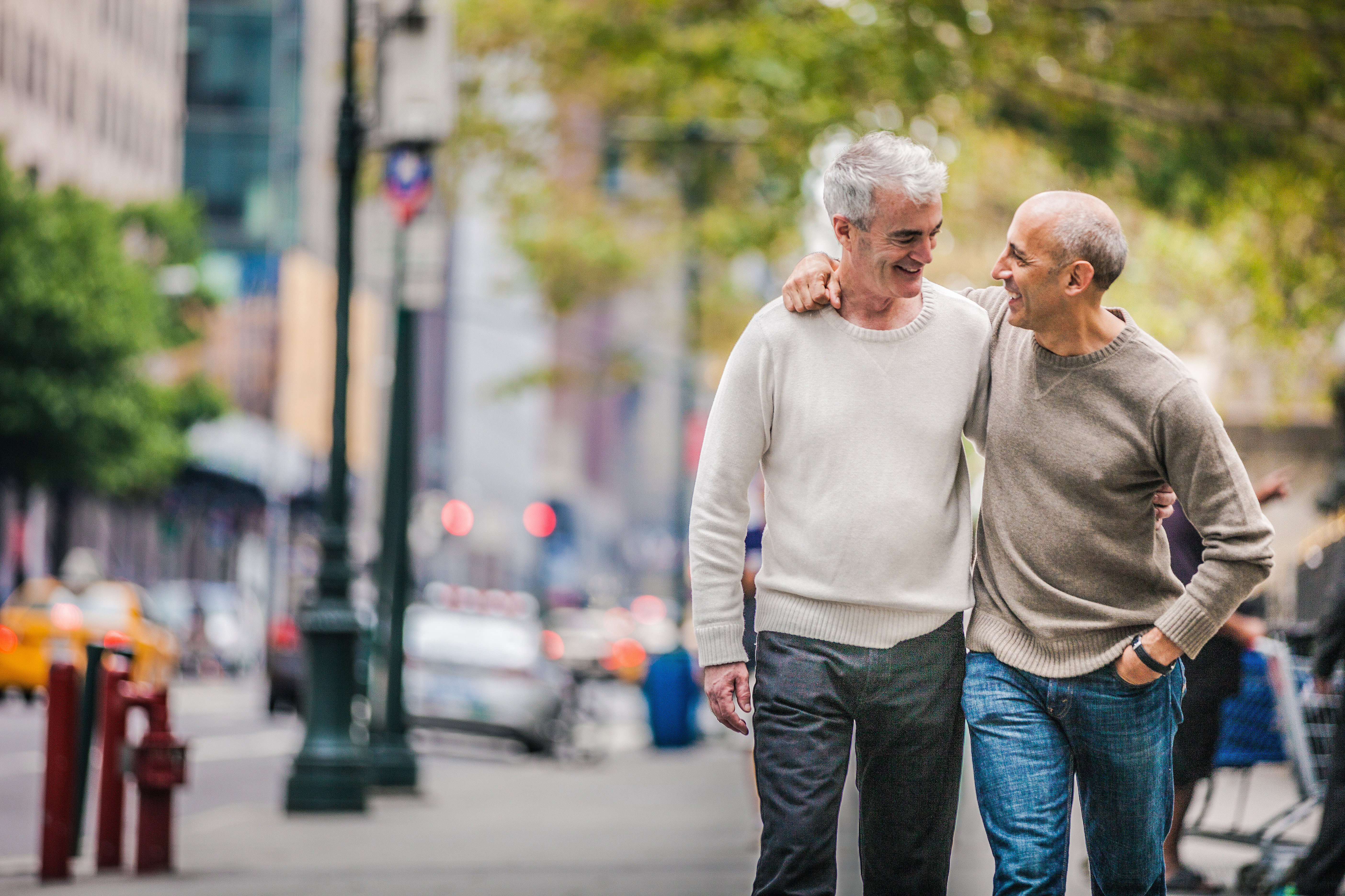 Gay couple walking in New York downtown